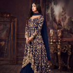 luminous-blue-color-heavy-net-embroidered-stone-work-sharara-suit