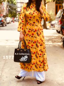 impeccable-yellow-color-american-crape-silk-kurti-with-plazzo