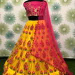 zari-and-classic-embroidery-work-yellow-color-heavy-net-party-wear-lehnga-choli