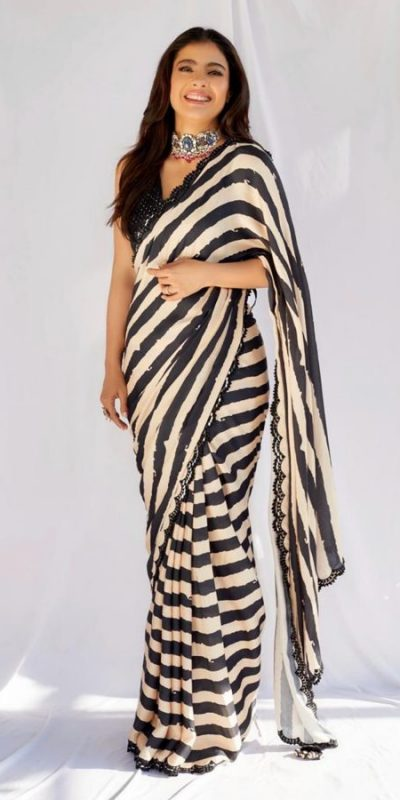 beauteous-kajol-in-black-white-striped-saree-with-heavy-sequence-blouse