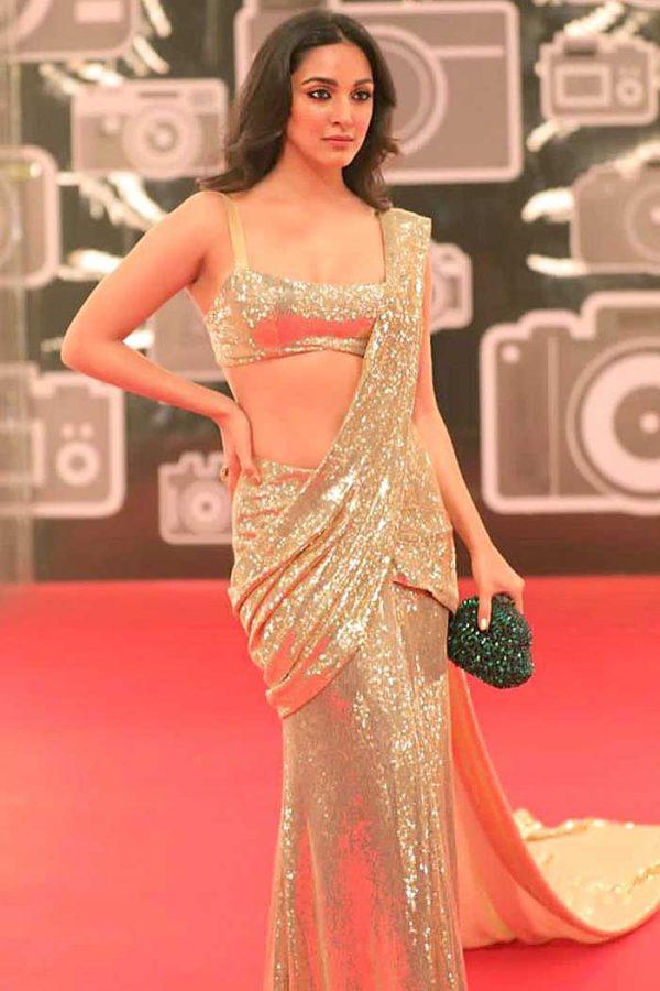 dazzling-kiara-advani-in-heavy-golden-color-sequence-saree