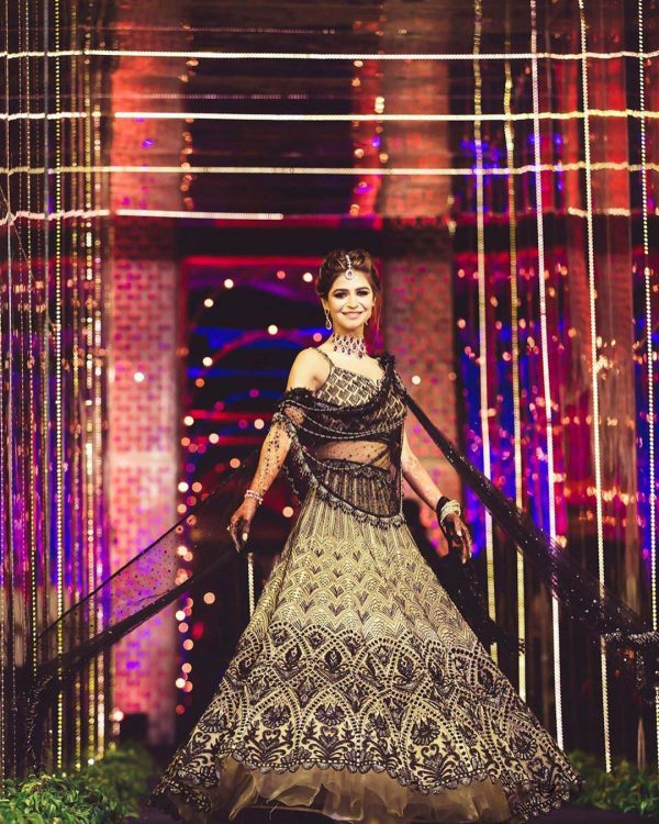 exotic-bridal-look-with-black-cream-color-sequence-embroidery-work-lehenga-choli