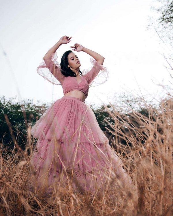 fantastic-pink-color-heavy-net-with-beautiful-ruffle-work-crop-top-lehenga
