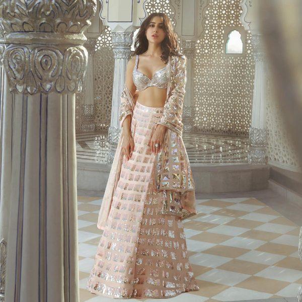 beauteous-sara-ali-khan-in-sequence-ivory-peach-color-designer-lehenga