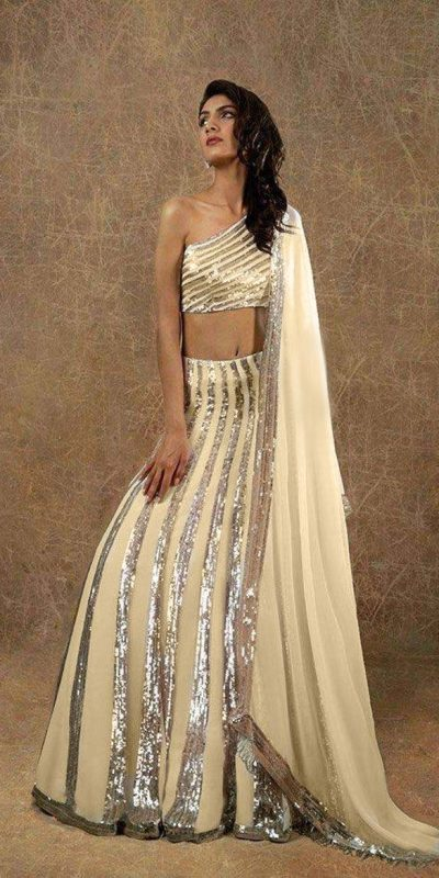 magnificent-cream-color-manish-malhotra-sequence-party-wear-lehenga