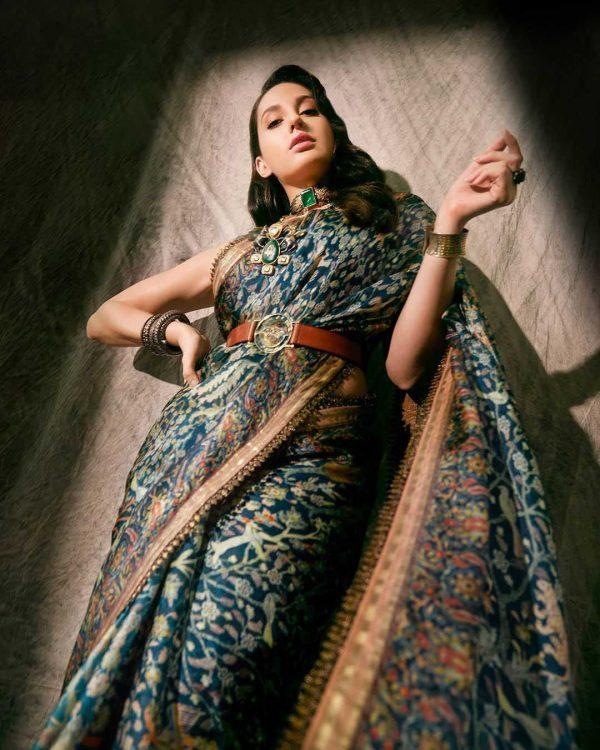 heavenly-nora-fatehi-in-peacock-blue-color-designer-printed-saree