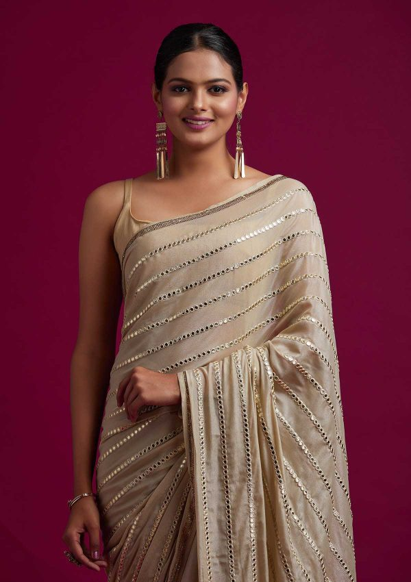 fashionable-gold-color-fancy-mirror-work-trendy-party-wear-saree
